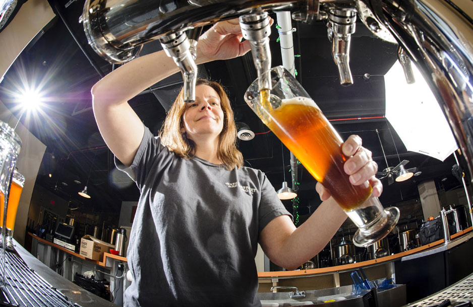 Woman pouring draft beer